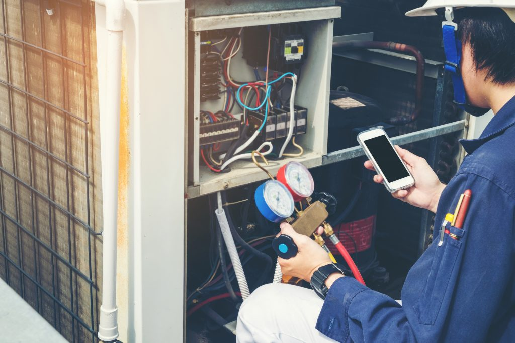 Technician Is Checking Air Conditioner Hvac Construction